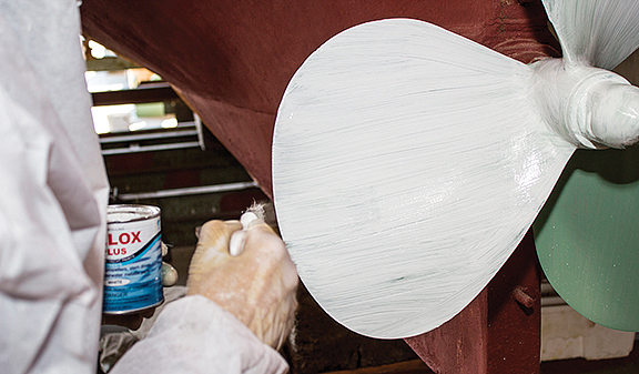 Applying first coat of Velox Plus Paint